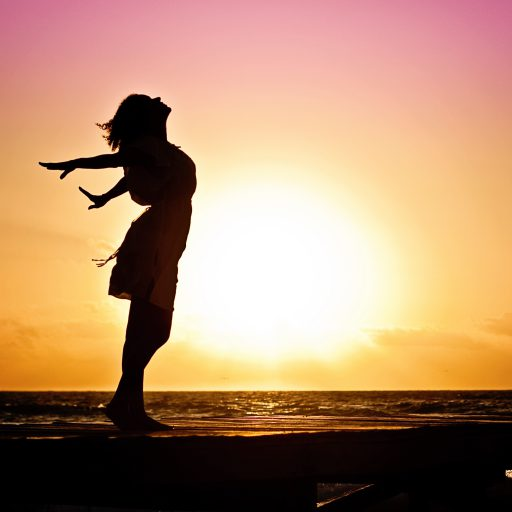 cropped-woman-happiness-sunrise-silhouette-401921.jpeg